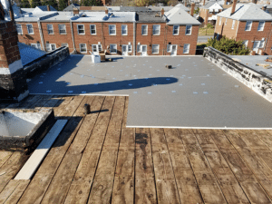 ISO board installation on flat roof