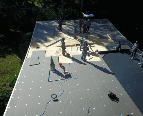 Roofing Maryland by Four Seasons Roofing working on the roof
