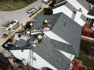 fixing a roof, people on the roof