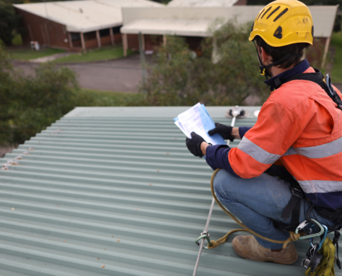 Rope,Access,Inspector,Technician,Holding,Looking,At,The,Paper,Work