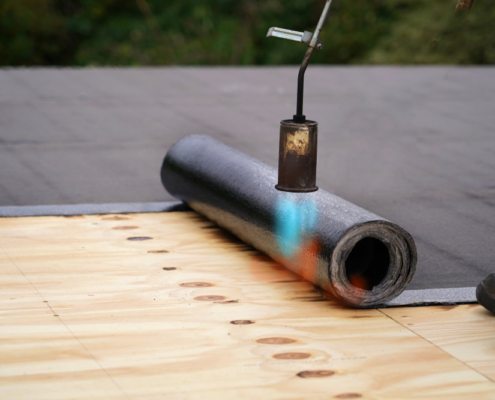 Bitumen,Roofing.,A,With,A,Gas,Burner,And,A,Roll