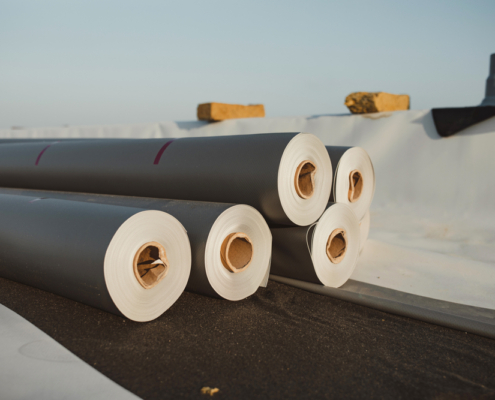 Roofing,Pvc,Membrane,In,Rolls,Placed,On,The,Roof,Of